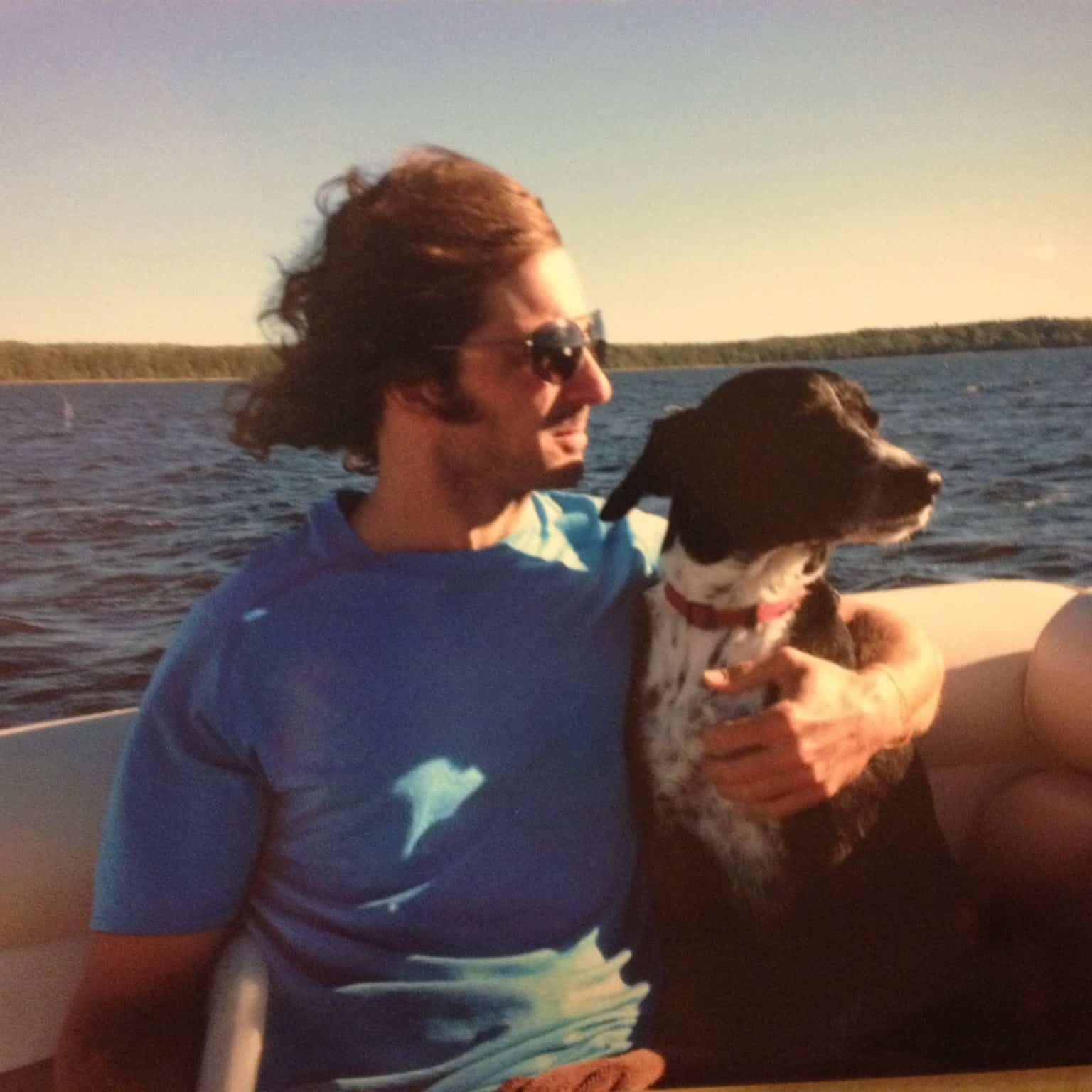 Will and hist dog Murphy in a boat